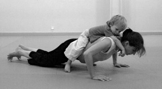 Lynne Wells pushup with child